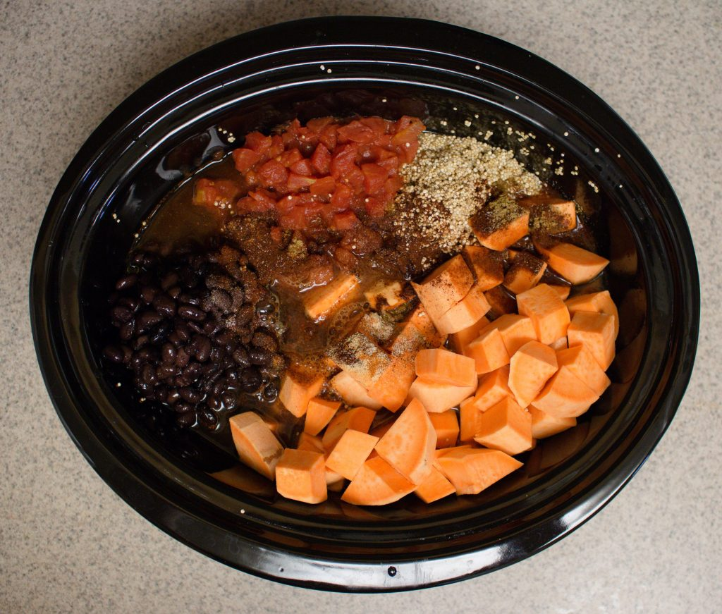 Need something easy, filling and delicious to make for dinner? Try this hearty quinoa fall stew! Full of sweet potatoes, tomatoes, chicken and black beans, it's the perfect balance of comforting and healthy! | Teaspoon of Nose