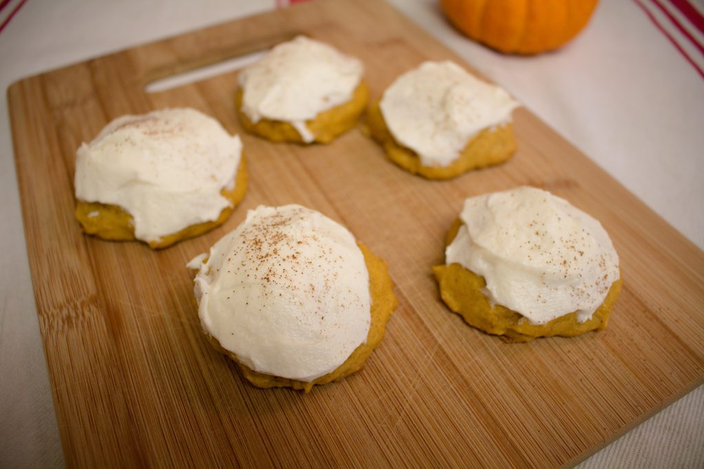 Frosted pumpkin cookies are the perfect way to celebrate fall! Try these next time you're looking for the perfect pumpkin recipe! | Teaspoon of Nose