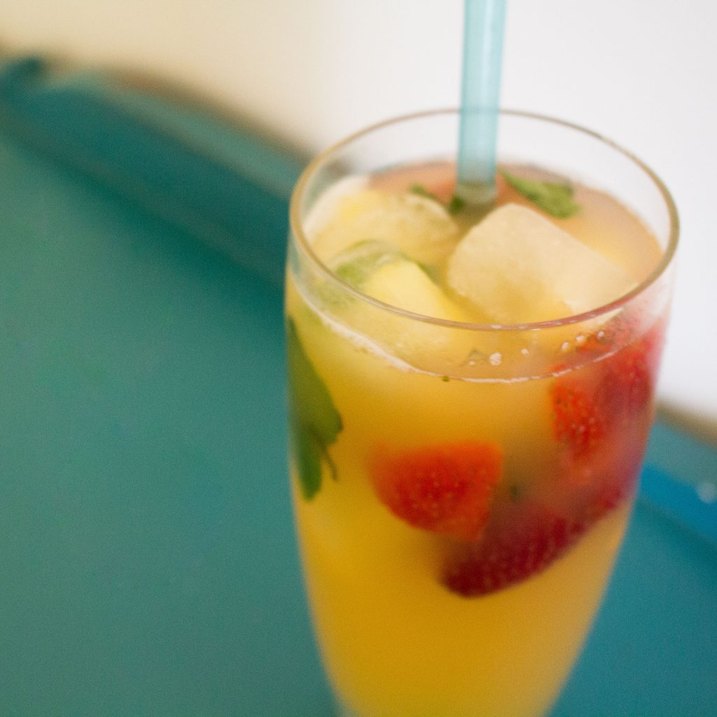 Pineapple strawberry punch makes the perfect mocktail for a summer afternoon!   Teaspoon of Nose