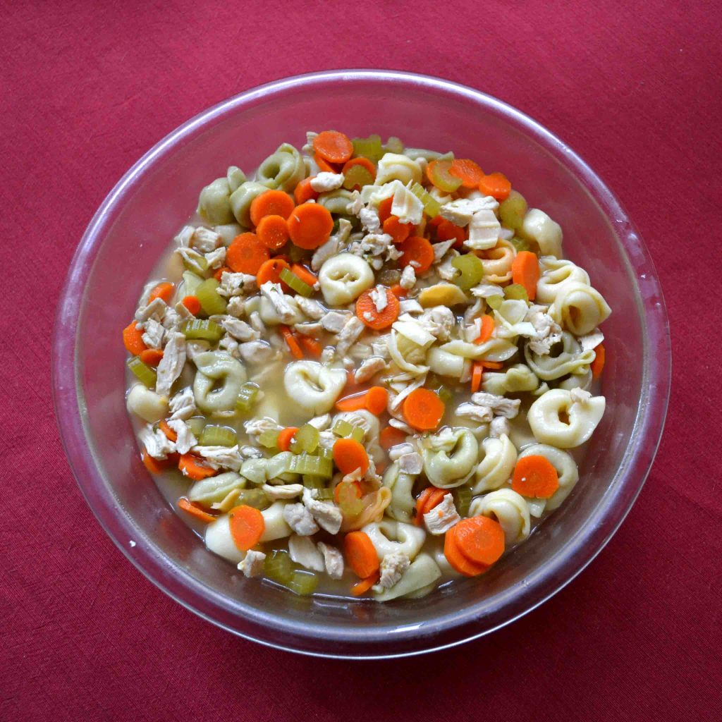 Tortellini chicken soup is a twist on a rainy day classic!   Teaspoon of Nose