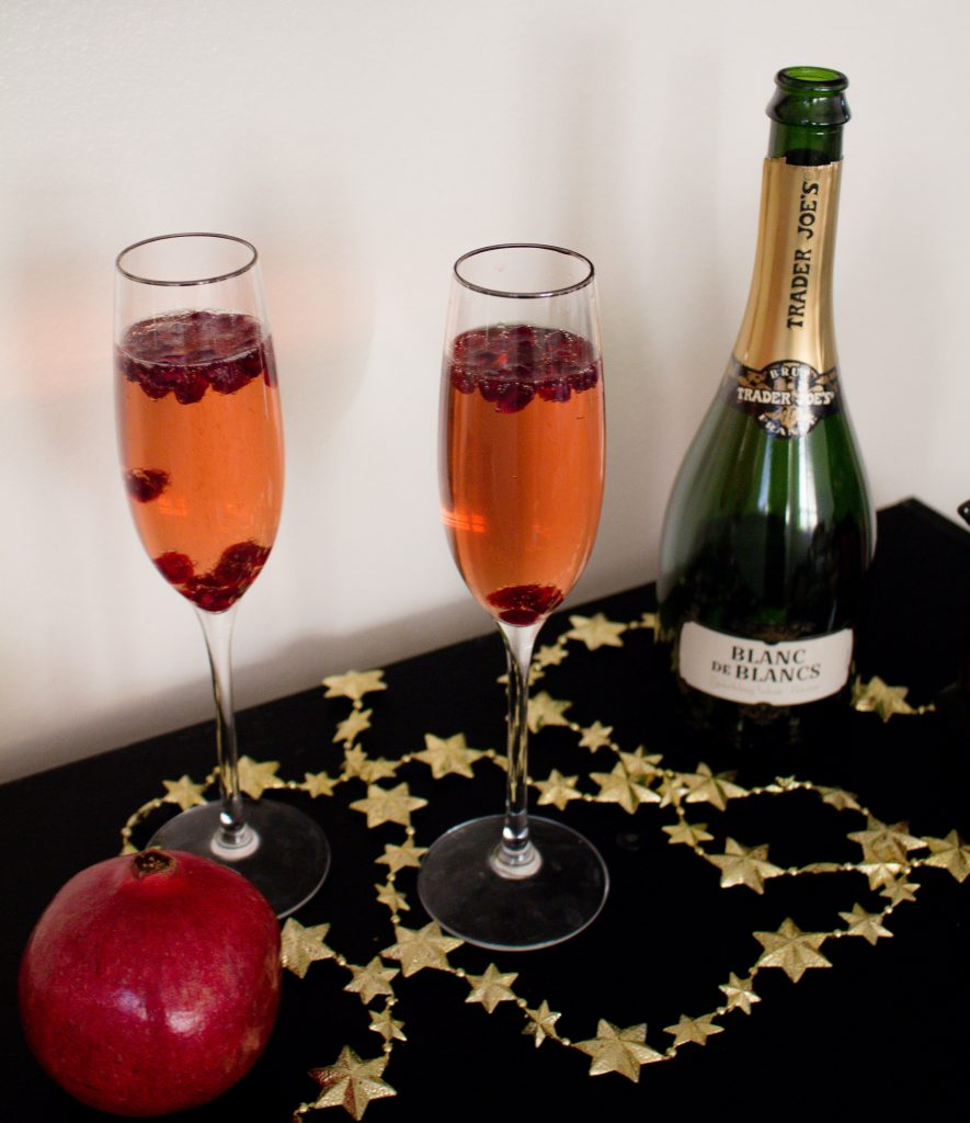 This pomegranate champagne cocktail makes the perfect drink for New Year's Eve! Festive and bubbly, they have the perfect mix of sweet and tart for ringing in the new year.