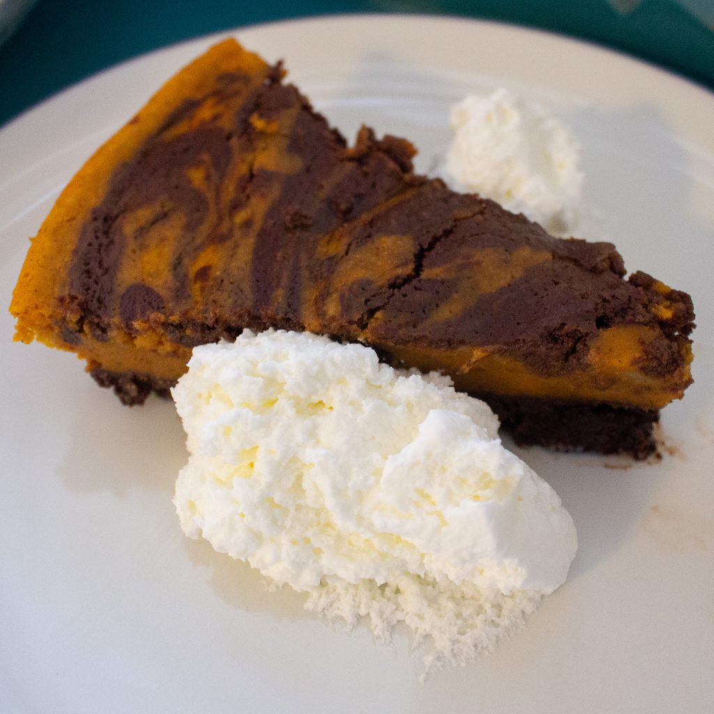 Pumpkin Brownie Pie is a mash-up of two classic American desserts: pumpkin pie and brownies! Perfect for Thanksgiving dessert!