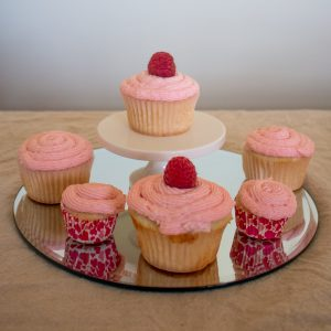 Raspberry Champagne cupcakes are light and fluffy, with champagne in both cupcakes and frosting and a zing of fresh raspberries to top it off! Bet you can't eat just one...