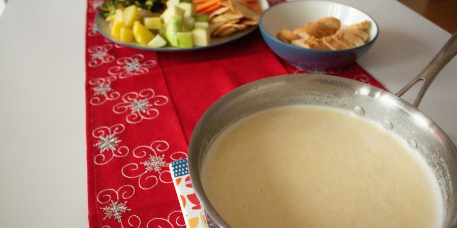 Cheese fondue is the perfect addition to your New Year's Eve party! It makes any gathering feel like a party, and this classic version is effortless to whip up!