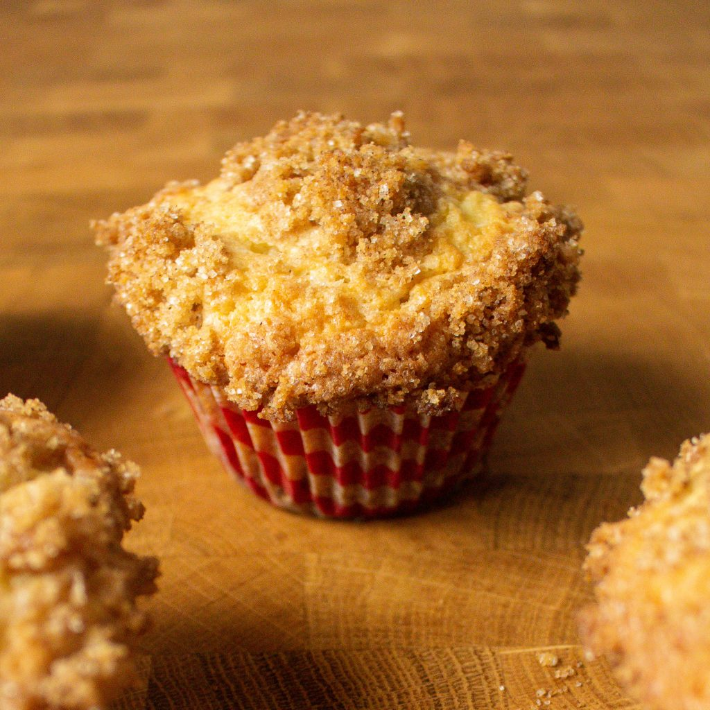 These apple muffins with streusel are the perfect sweet breakfast option with a secret ingredient that makes them perfect for spring!