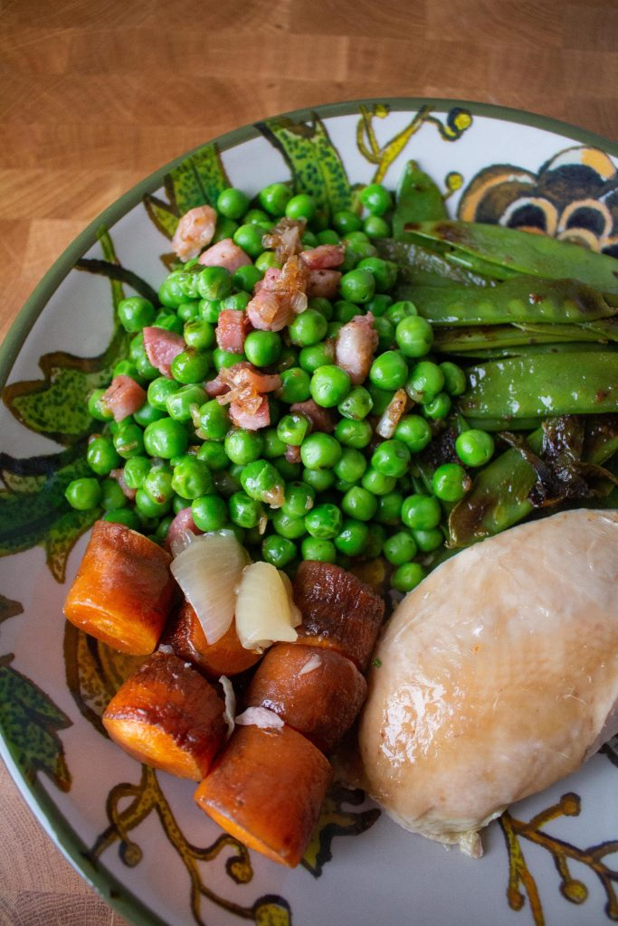 Peas with pancetta are the perfect easy side dish! The pancetta makes them seem elegant, but they're simple enough to toss together in ten minutes!