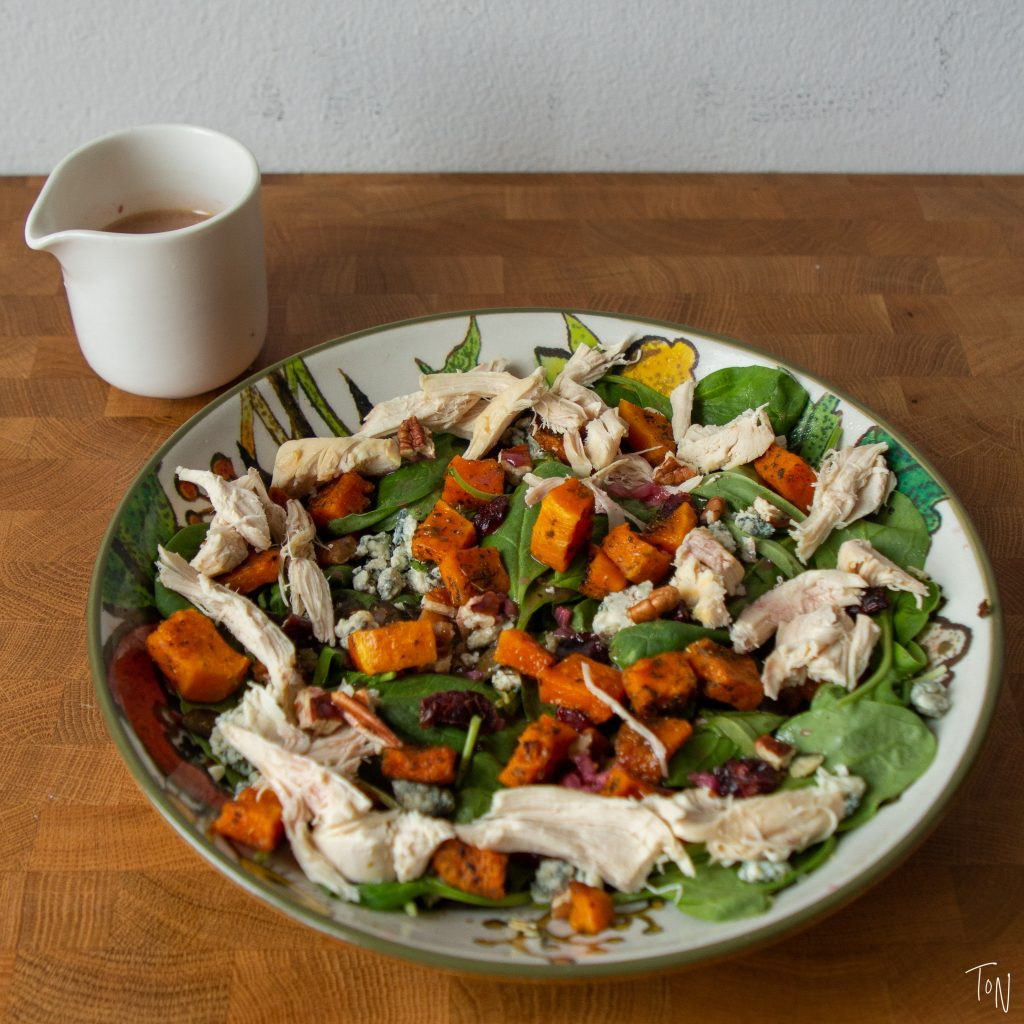 Complete with turkey, butternut squash, and cranberry vinaigrette, fall thanksgiving salad tastes just like the big meal!