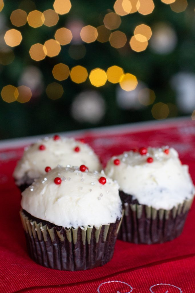 Packed with deep chocolate flavor and topped peppermint swiss meringue buttercream, dark chocolate peppermint cupcakes are the Christmas dessert you didn't know you needed!!