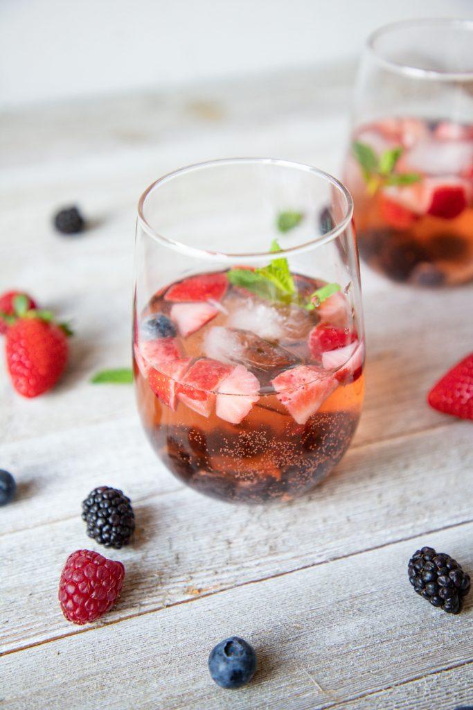 Berry rosé sangria is the perfect picnic sip! It's perfect to take on a day trip to the lake or the park, or just for a summer evening! | Teaspoon of Nose